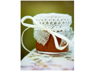 Honey jar decorated with grey linen and laces