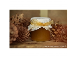 Honey jar decorated with linen and golden ribbon