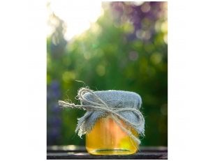 Mini honey jar decorated with linen and jute ribbon